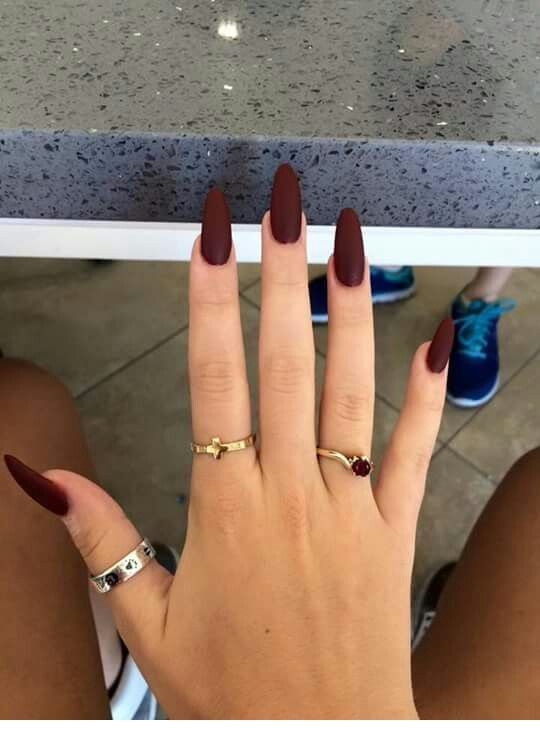 Long brown nails with cute rings