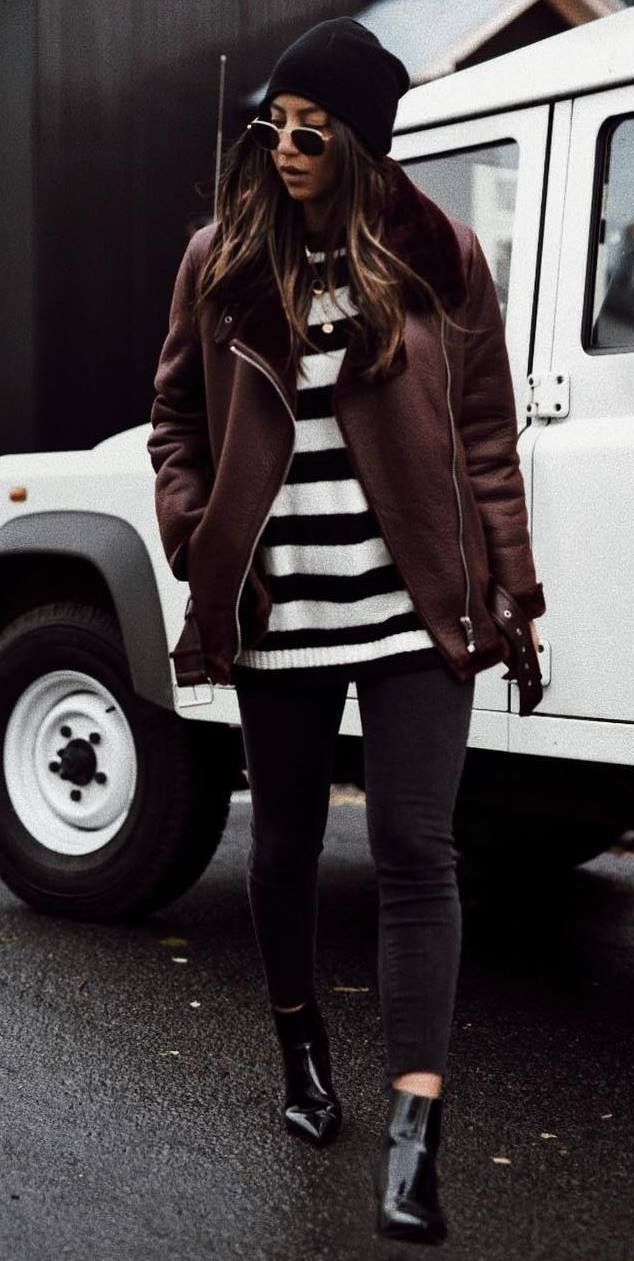 cozy fall outfit / maroon jacket hat striped sweater skinny jeans boots