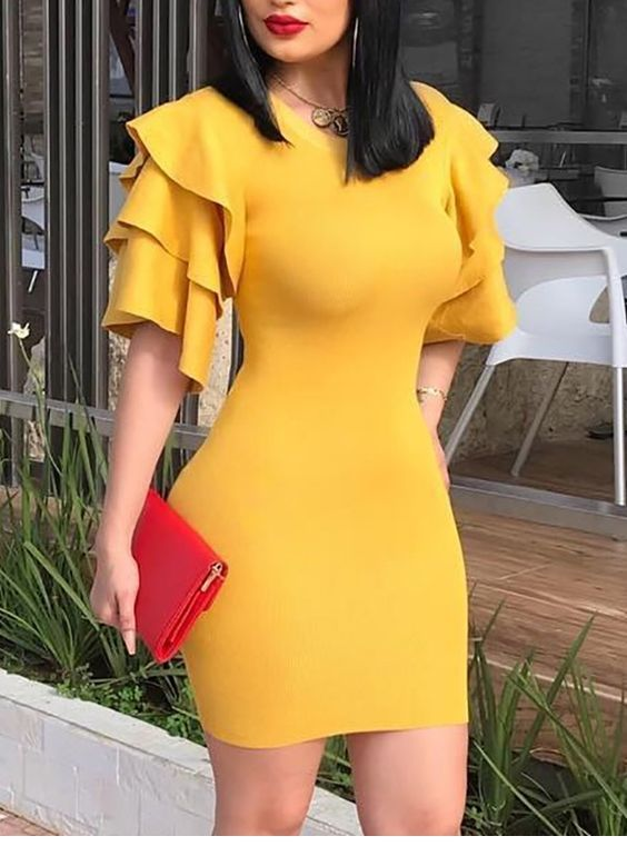 Yellow dress and red details