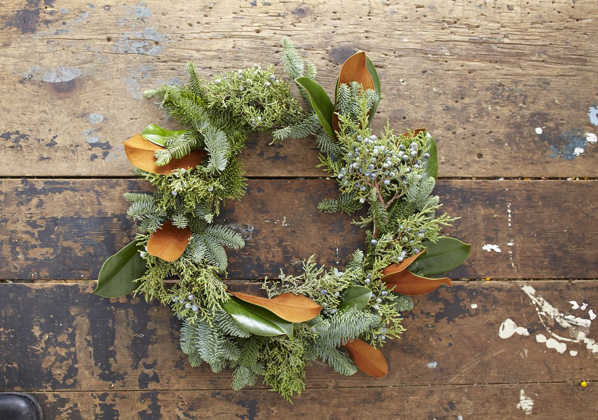 Follow these easy instructions to make a seasonal wreath with magnolia leaves, juniper, and pine