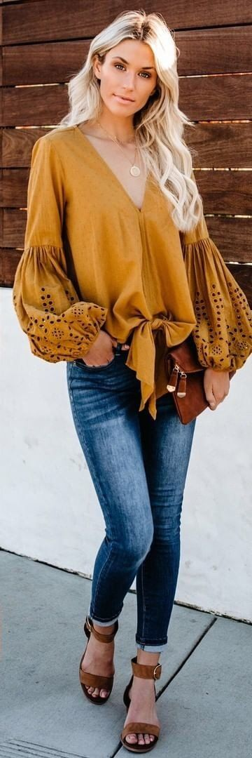 brown V-neck long-sleeved blouse and blue denim jeans #spring #outfits
