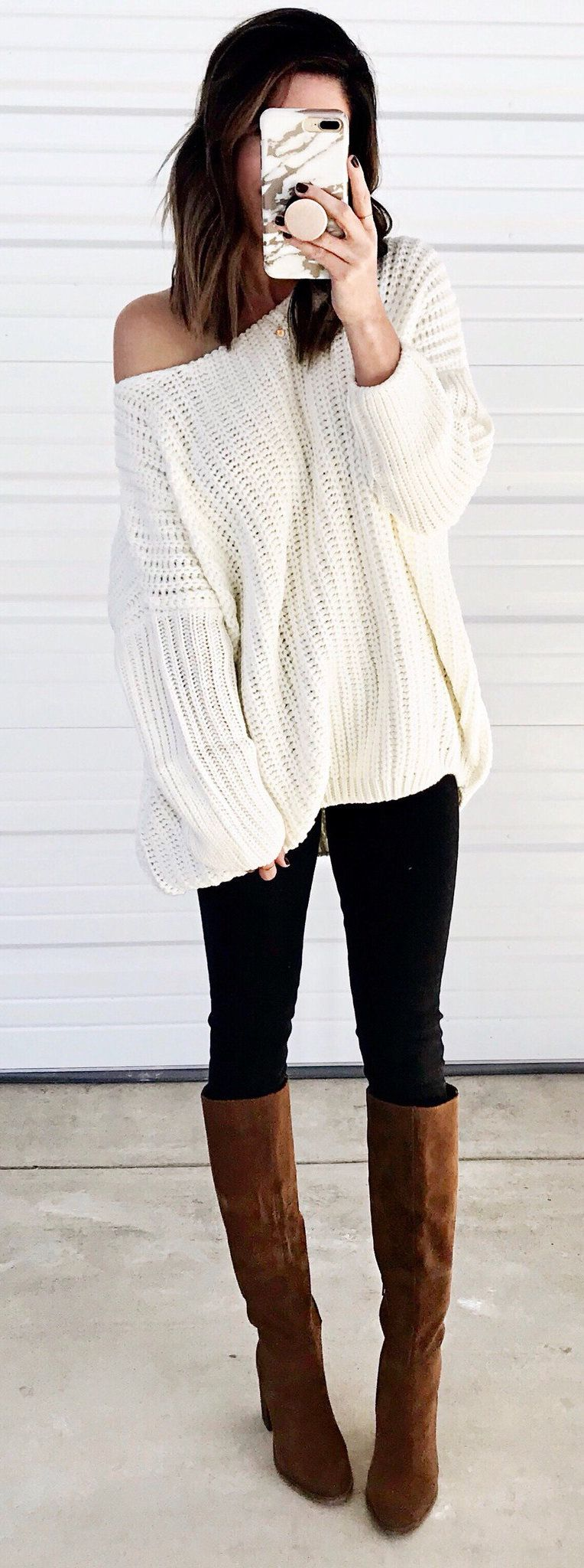 beige sweater, black leggings, and pair of brown suede boots