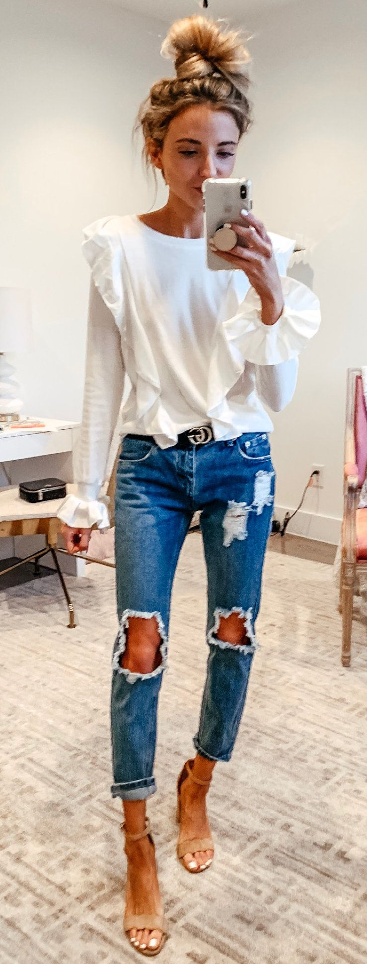 white long-sleeved ruffled shirt and distressed blue denim fitted jeans #spring #outfits