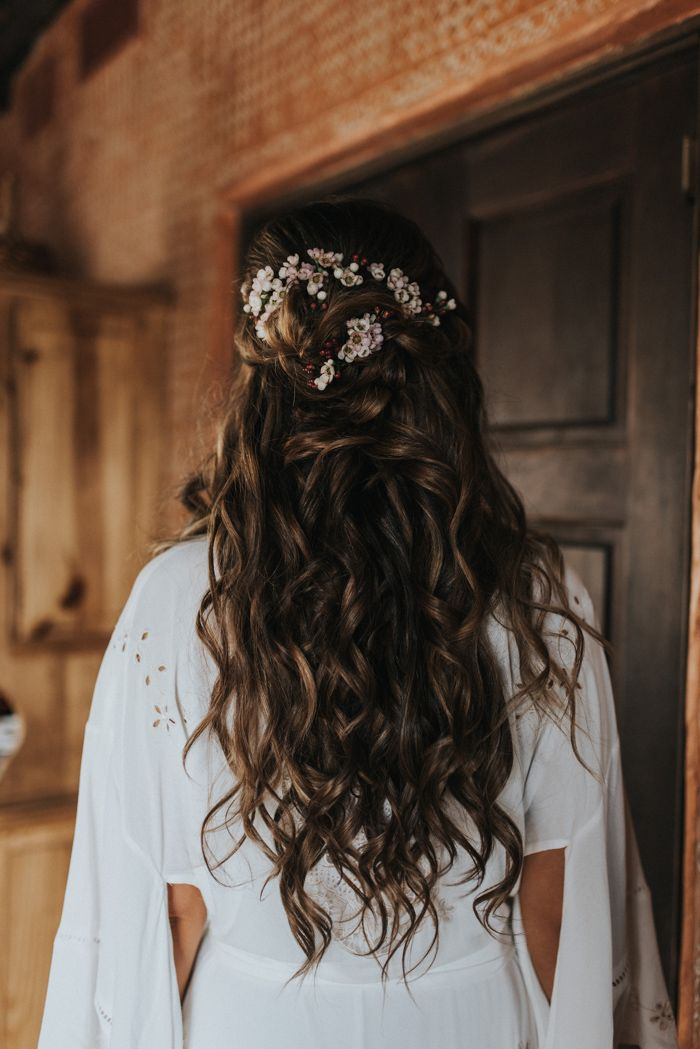 The bride wore her hair half up with sweet flowers for a romantic look | Image by Jonnie + Garrett