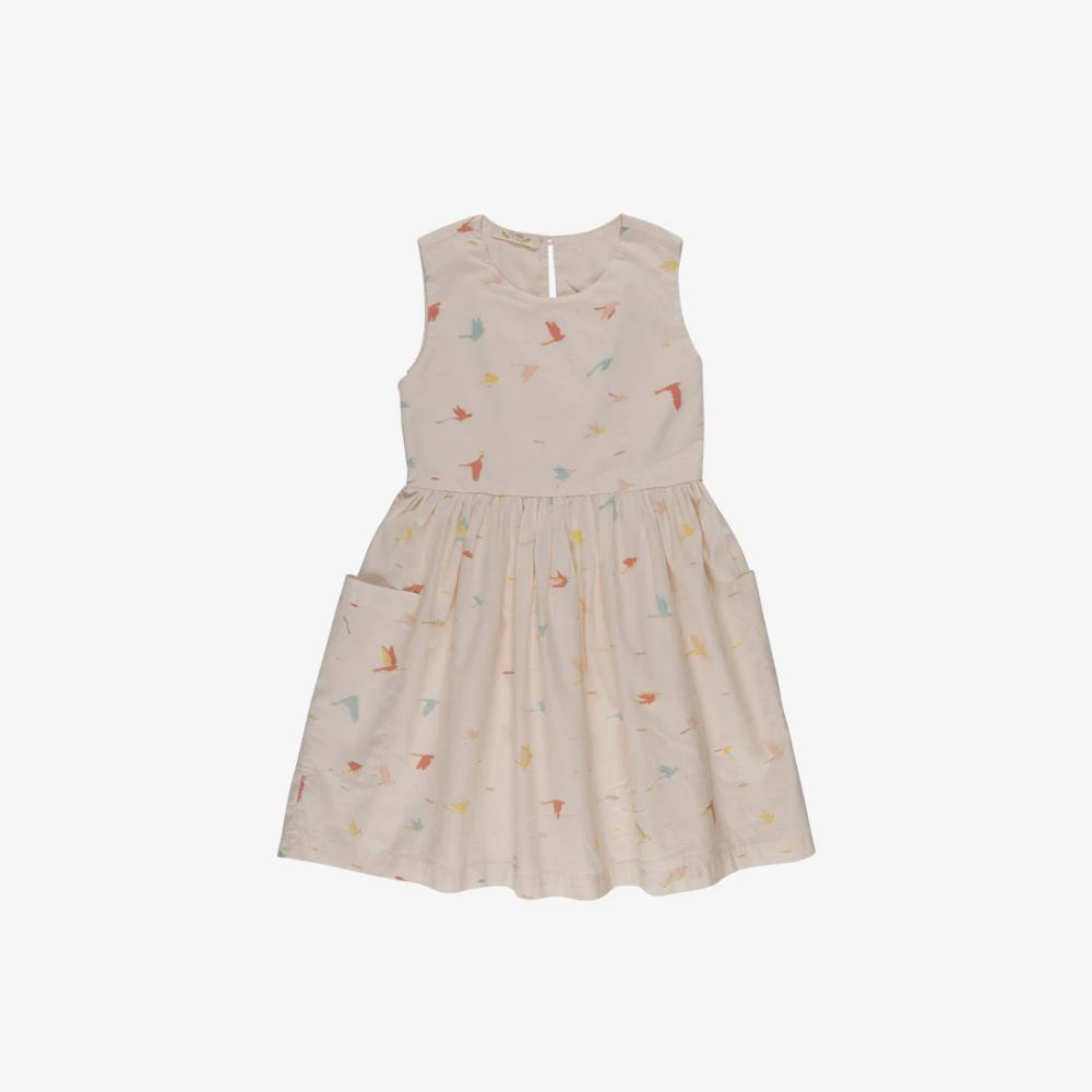 Afresh and painterlyTropical Birdsprinton a classic jumperDress.The lovely hand-drawnprint depictscolorful rainforest birds on a palePink TintPima cotton garment-dyed woven. Features sleeveless boxy bodice designed so the dress can be worn alone or layered over tops, wooden buttons down the back bodice for ea