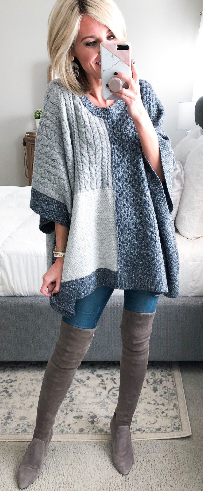 gray and white crochet poncho and brown knee-high boots