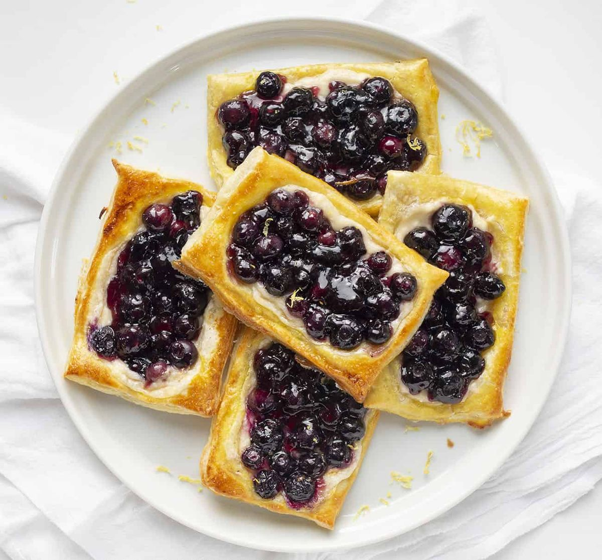This Lemon Blueberry Danish is a light and fluffy pastry topped with a cream cheese mixture, blueberry jam, and fresh blueberries.