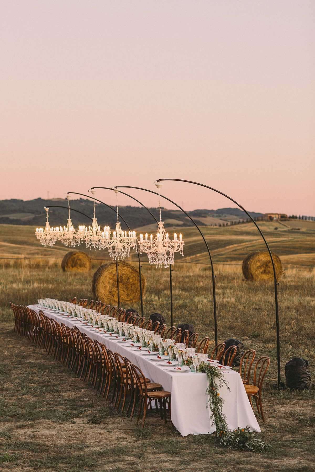 An Intimate Tuscan Wedding Featuring a Hillside Reception Under Sparkling Chandeliers