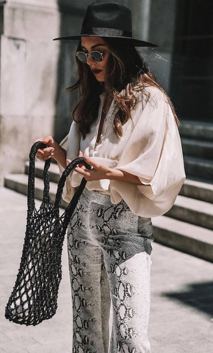 stylish look / black hat blouse bag snake pants
