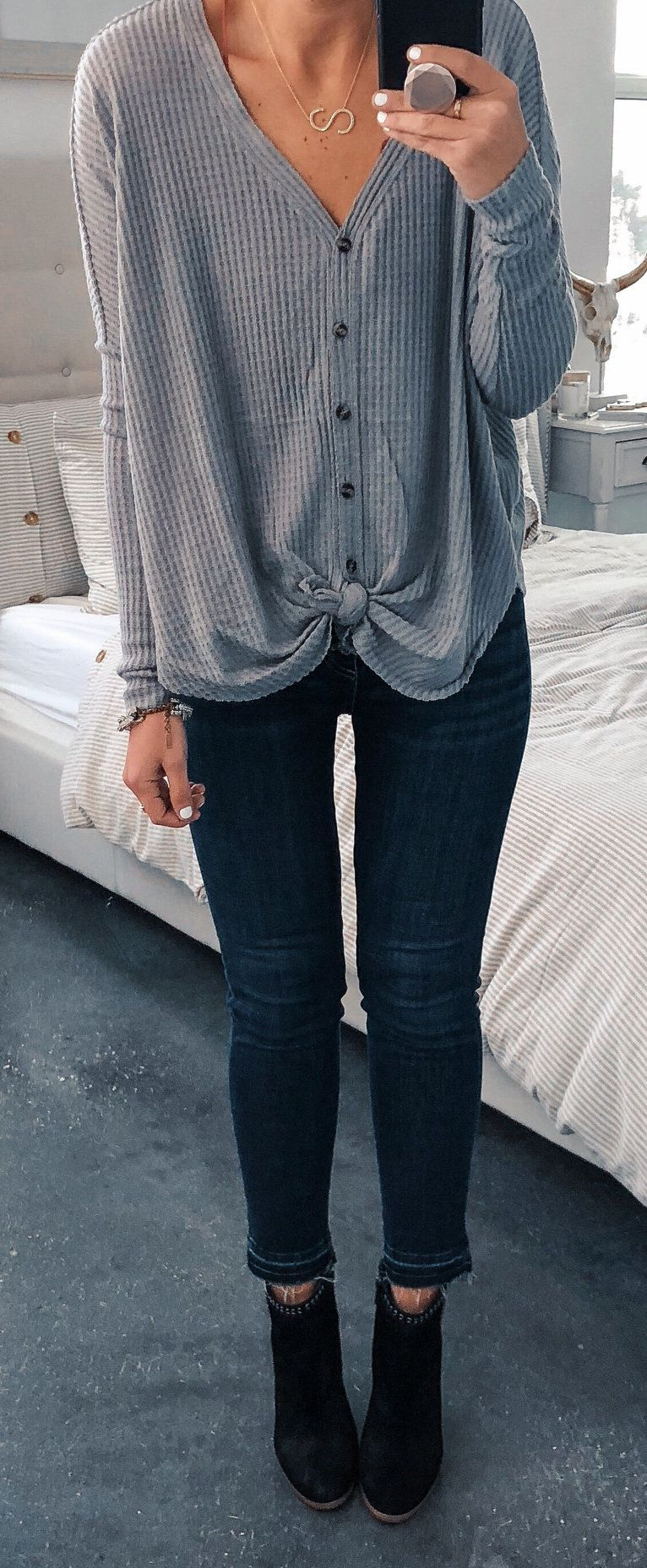 gray button-up sweater