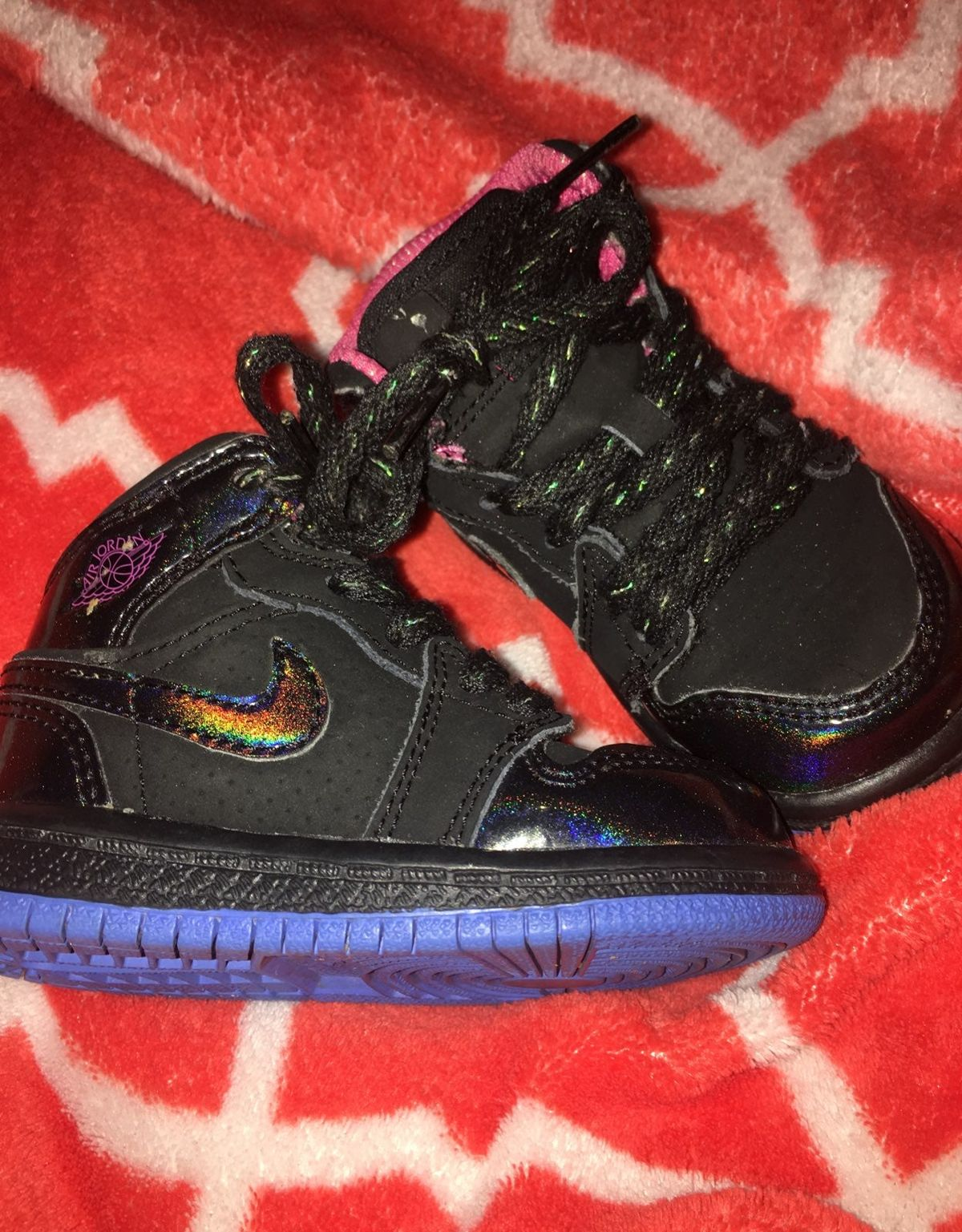 super cute pink, black, and blue jordans. Size 4c. these have been worn multiple times but are in next to perfect condition.