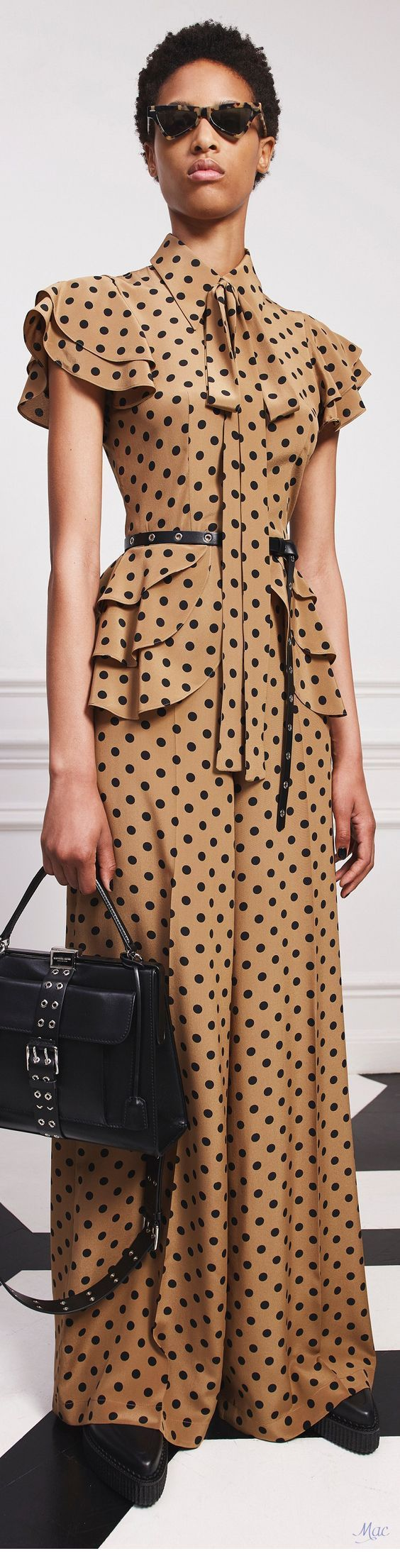 Long polka dot dress with black accessories