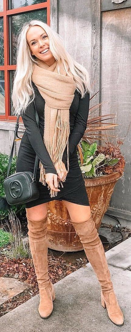 beige scarf and black top