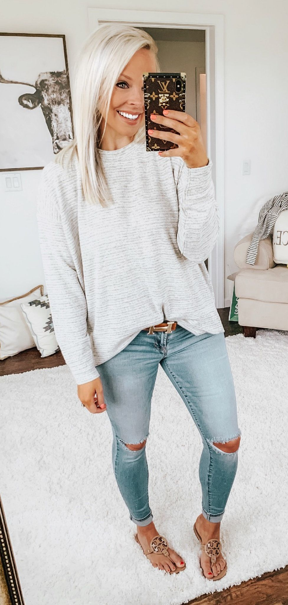 grey long-sleeved shirt and distressed blue denim skinny jeans #spring #outfits