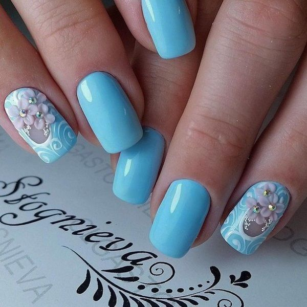 The baby blue Floral Nail Art Design. The baby blue glossy nails are so going to be the best nail color for you, if you are having a perfect night out with someone special.