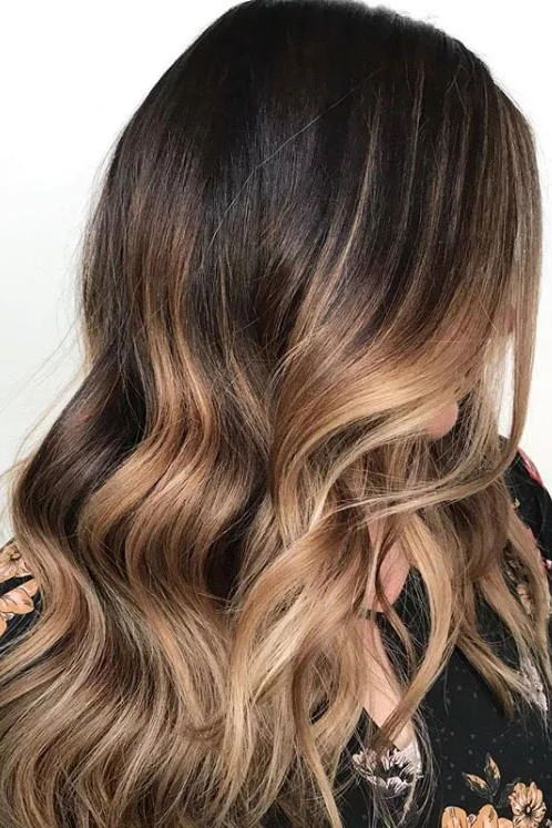 Butter-Caramel Melt | Make a dramatic statement by going dark espresso brown to buttery caramel-blonde. This color melt by stylist Carolynn Judd drips with style. #hairtrends #colortrends #southernliving #caramelhair