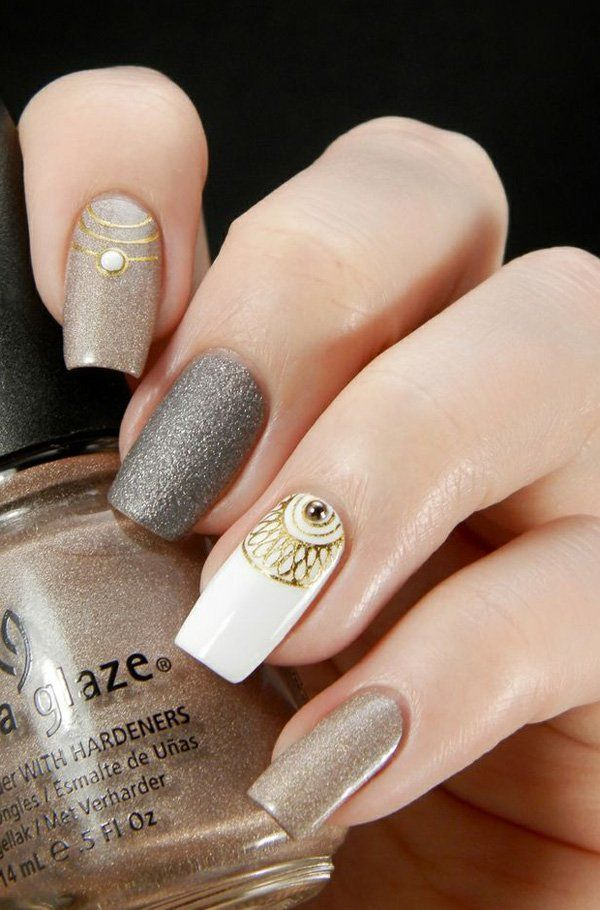 Gray and gold glitter with white nail polish. Give your nails that elegant vibe with gray and gold glitter nail polish with an intricate design topped with gold and white beads on top.