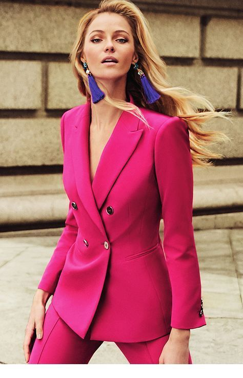 Cool pink suit and blue earrings