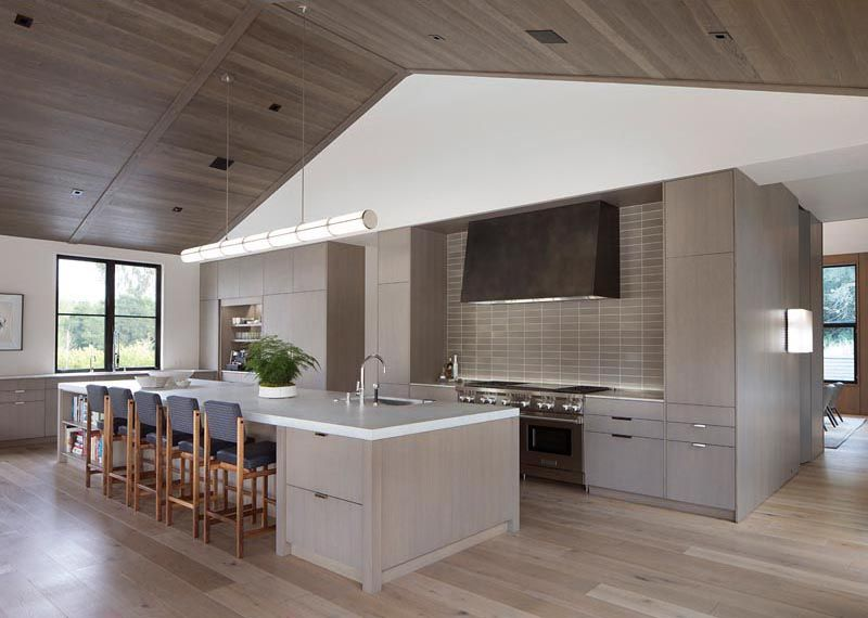 A Wood Ceiling Adds Warmth Inside This Modern Farmhouse