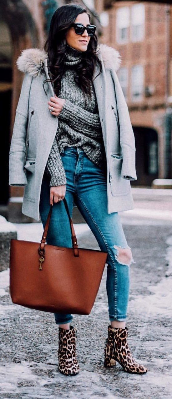 gray knit sweater and blue denim pants