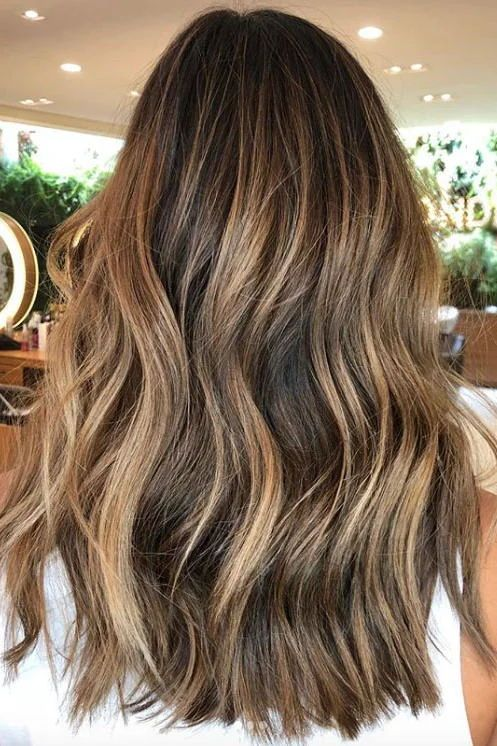 Beachy Caramel | Who doesn't want strands that look enviously kissed by the sun? Luckily, some well-placed balayage can do that year-round. #hairtrends #colortrends #southernliving #caramelhair