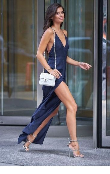 Amazing navy dress with silver sandals and white bag