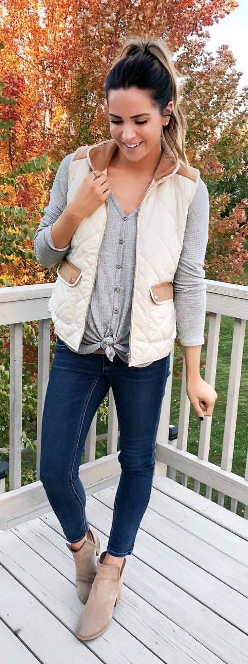 beige and brown vest