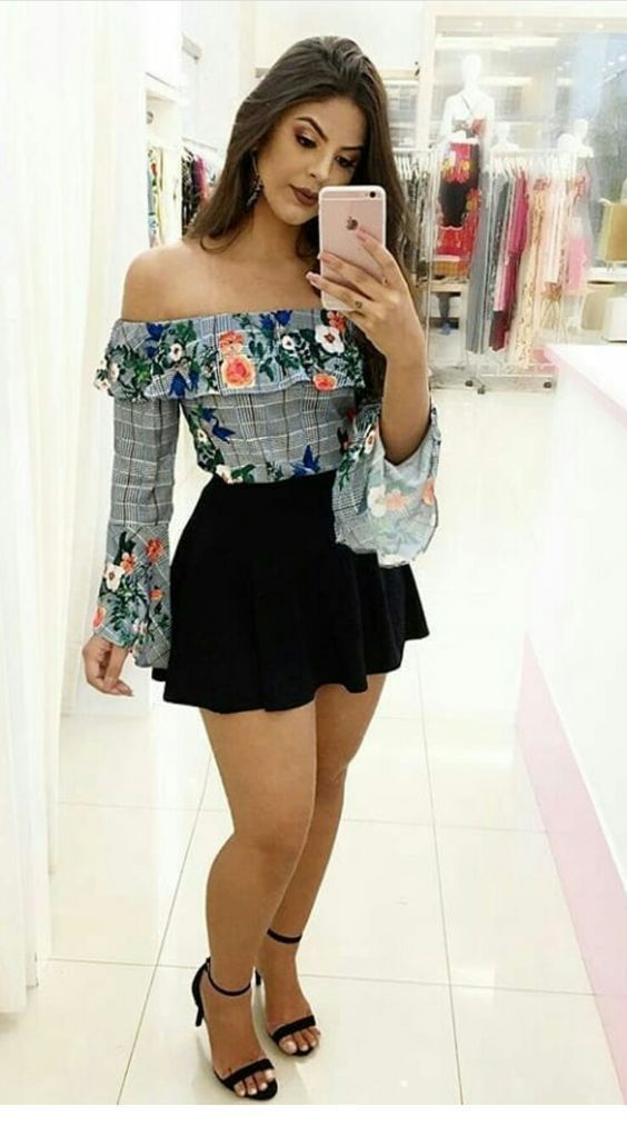 Cute floral blouse and a black skirt