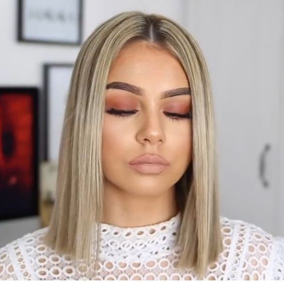 Short blonde hair and brown makeup