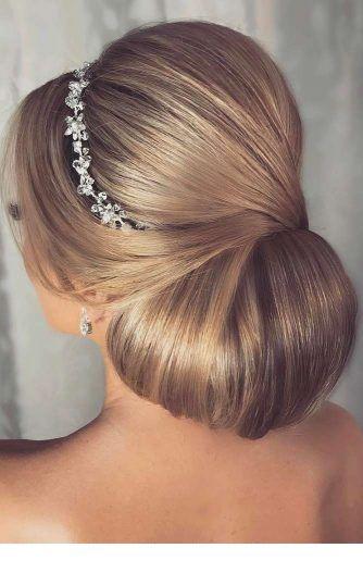 Nice low bun for wedding with a nice hair accessory