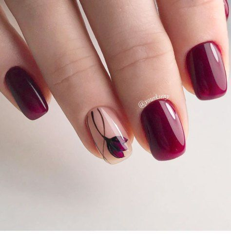 Burgundy gel nails with a flower
