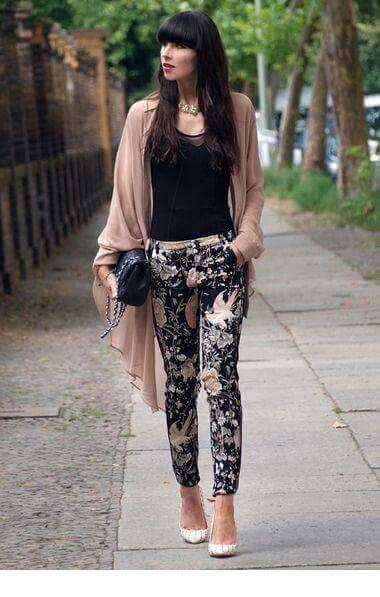 Black top, printed pants and an oversize cardigan