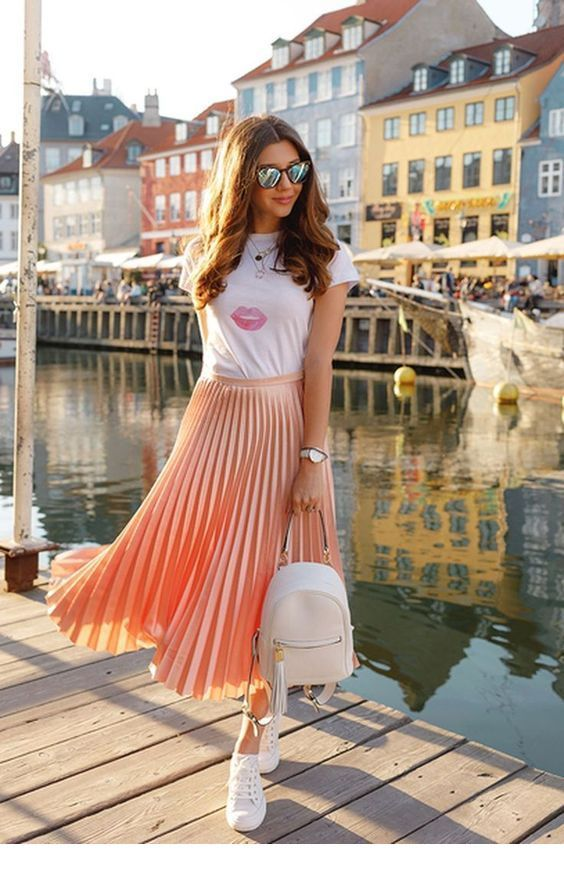 White t-shirt and light orange midi skirt