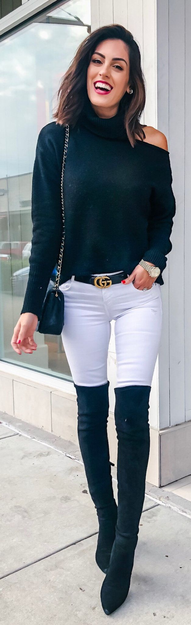 black long-sleeved top, white jeans, and black knee-high boots outfit