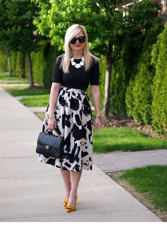 Cute black and white outfit with orange pumps
