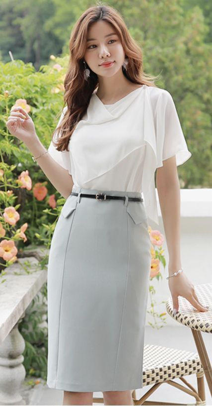 White top, grey skirt and black belt