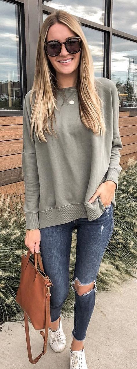 gray crew-neck sweater and distressed blue denim jeans