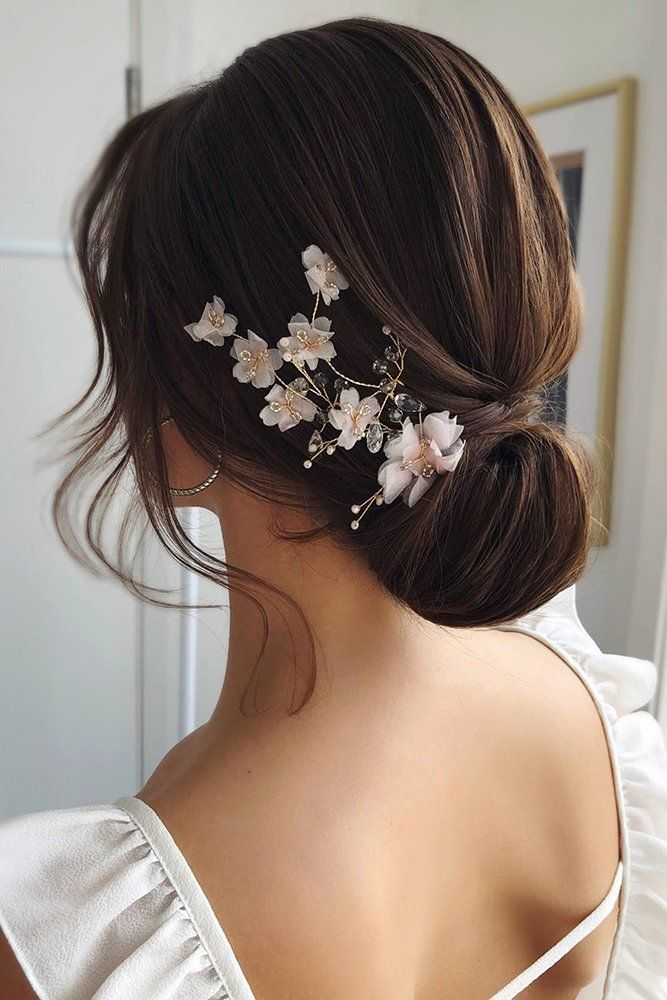 Hot Wedding Hair Trends 2020 ❤ wedding hair trends brown elegant chignon with white flower accessorie caraclyne.bridal #weddingforward #wedding #bride #weddinghair #weddinghairtrends