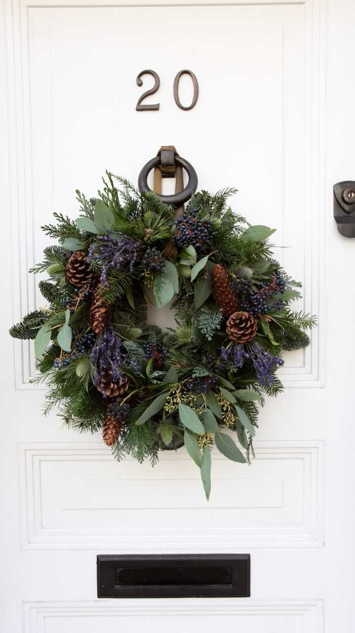 Beautiful natural Christmas wreath with pine cones