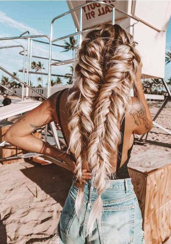 Most beautiful and adorable ideas of fishtail braids for ladies to show off on their wedding day.