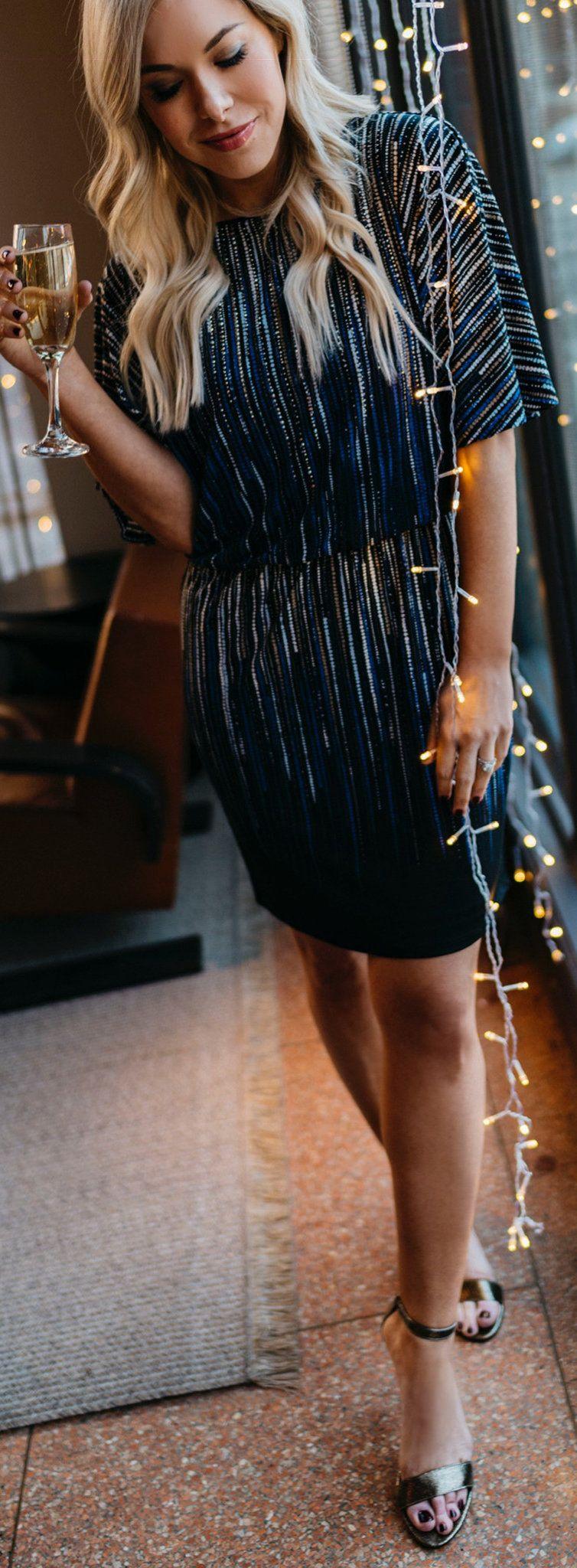 black elbow-sleeved mini dress
