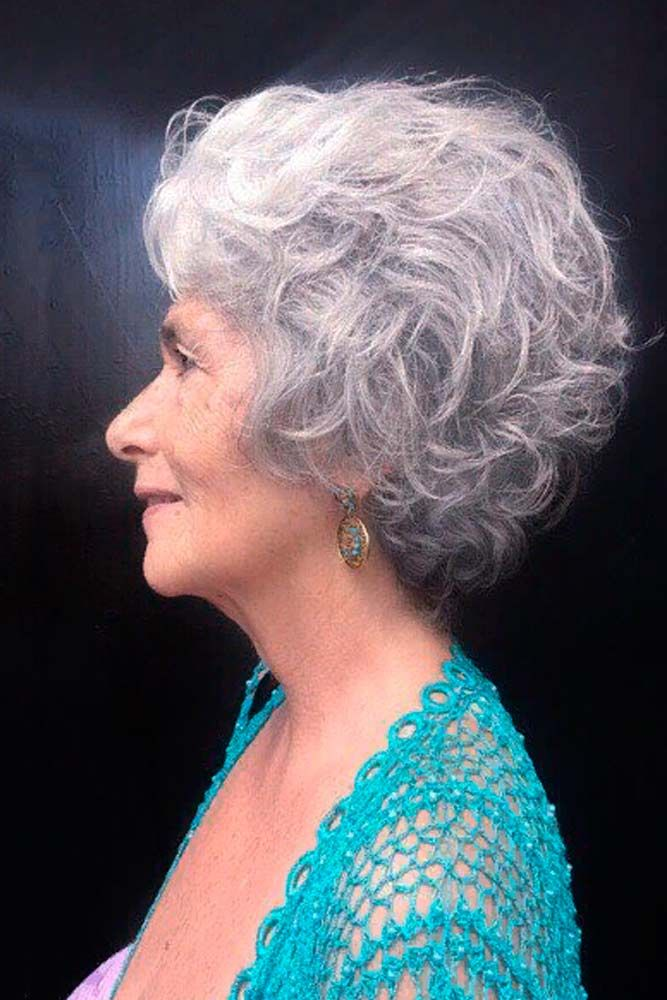 Soft, Tousled Waves #curlyhairstyles #greyhair ★ Short haircuts for women over 50 are special due to their ability to revive the image of a woman and to make her appear years younger. 50 is not the end of the world, trust us. In this post, you can explore the cuts that will enhance your features and cut off some years. Ready? #glaminati #lifestyle #shorthaircutsforwomenover50