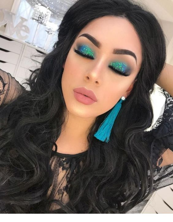 Amazing blue eye makeup and long earrings