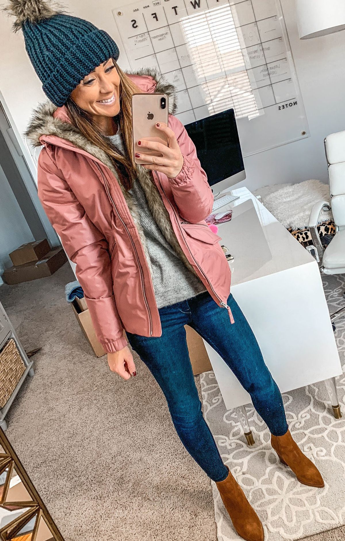 pink fur-lined zip-up coat
