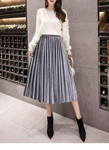 White sweater and gren midi skirt