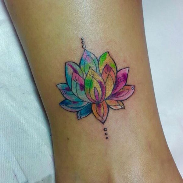 Rainbow Lotus Flower Tattoo Design – Cute, Colored, Black and White, Large and Small Lotus Tattoos. Ankle, Wrist, Back, Forearm Tattoos. #tattoos #tattooideas #lotustattoo #lotusflower #tattoosforwomen #smalltattoos