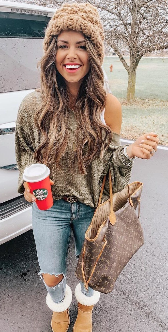 gray top and gray distress jeans