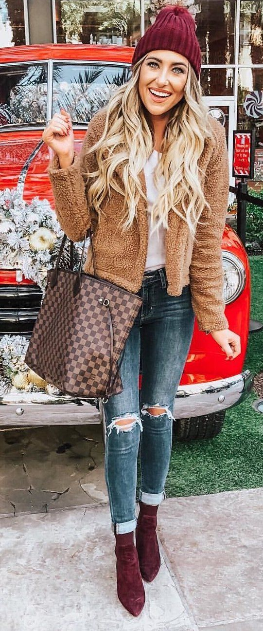 brown fleece jacket and Damier Ebene Louis Vuitton handbag