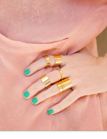 Mint nails and gold rings