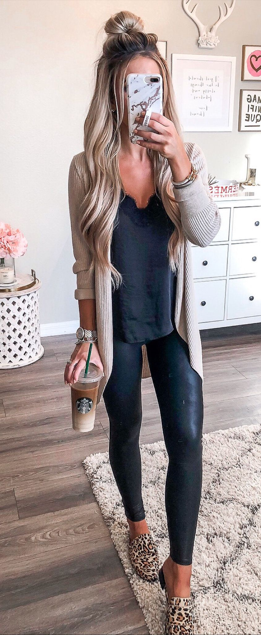 blue camisole; white cardigan; black fitted leggings